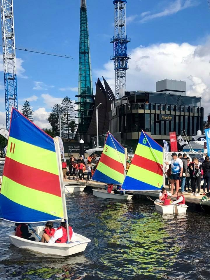 Kids sailing boats in Elizabeth Quay at the Perth International Boat Show
