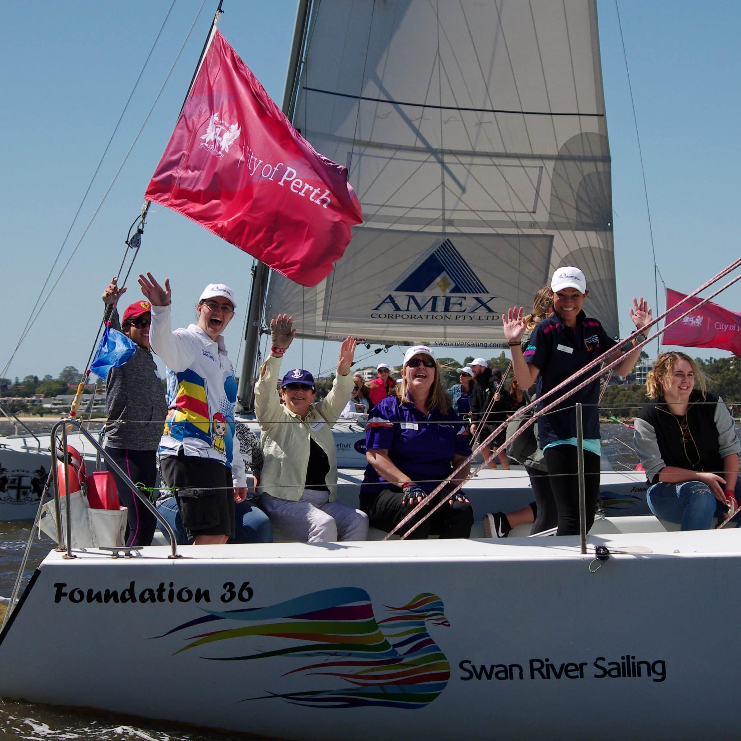 female sailors on a corporate sailing charter in perth with swan river sailing