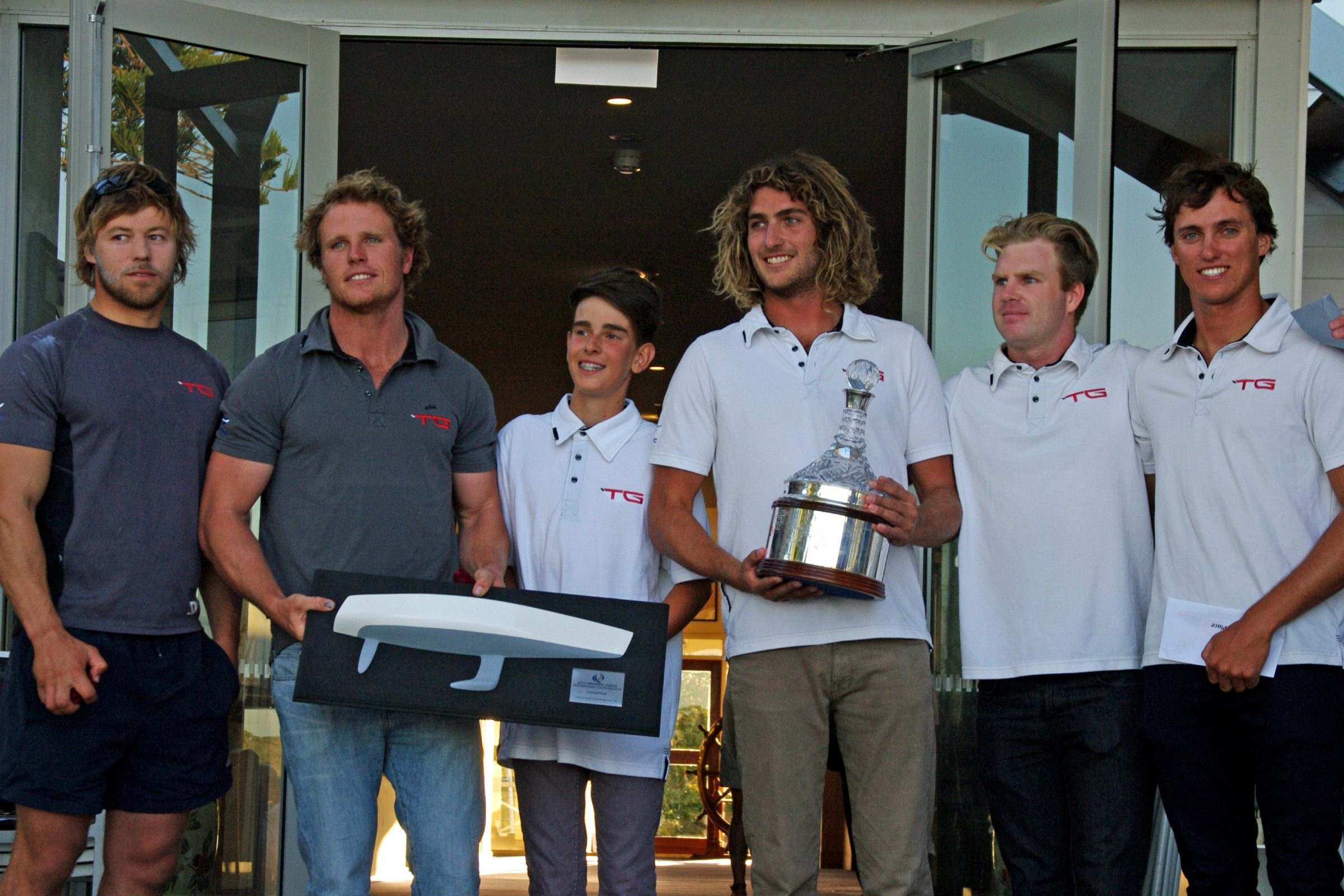 David Gilmour and crew from the royal perth yacht club , winners of the 2014 warren jones international youth regatta, organised by swan river sailing, an iconic youth match racing regatta in perth, western australia